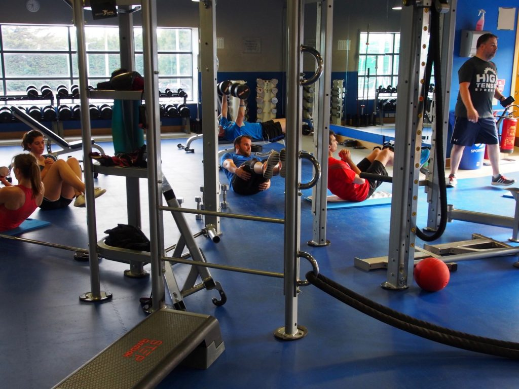 """My Functional Training class suffers in solidarity during a """"relaxing break"""" (LOL nope) that consists of ab sits."""