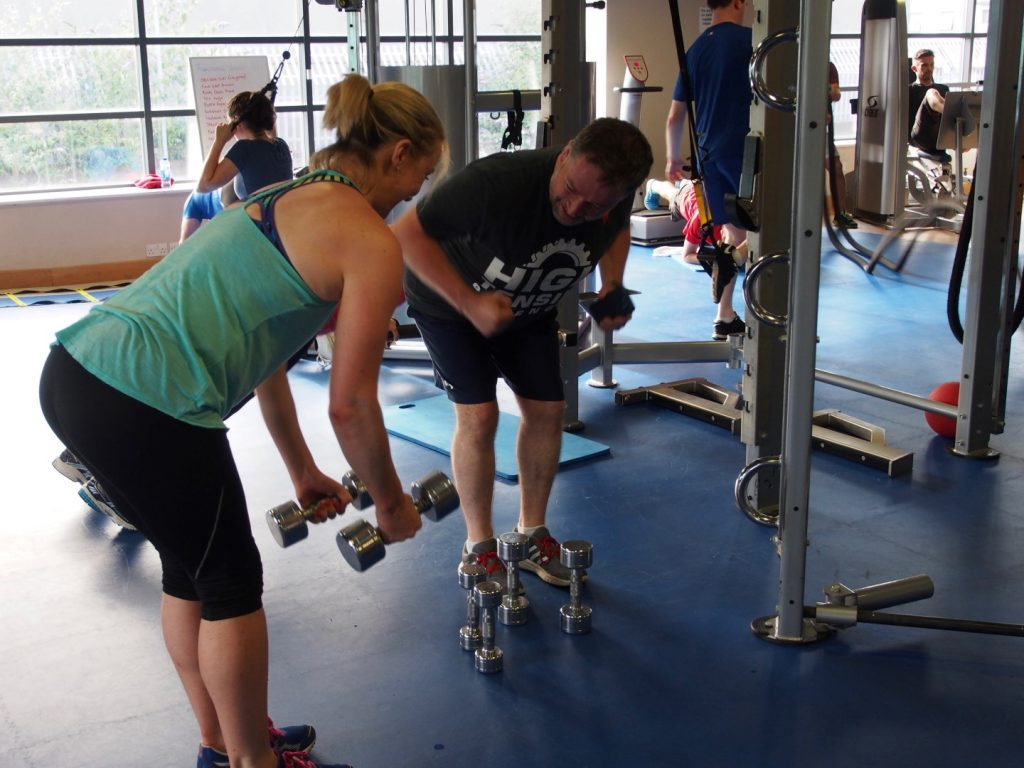 Brian helping a class member improve her form.