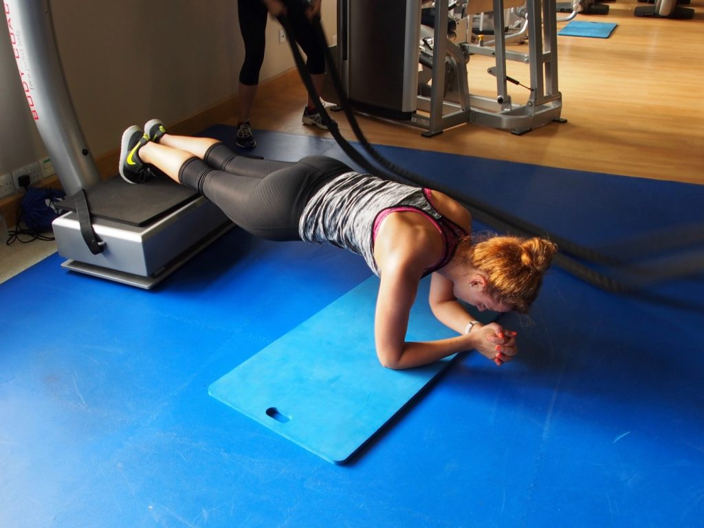 Underfoot, a machine that vibrates to add resistance to and crank up the difficulty of this plank exercise.