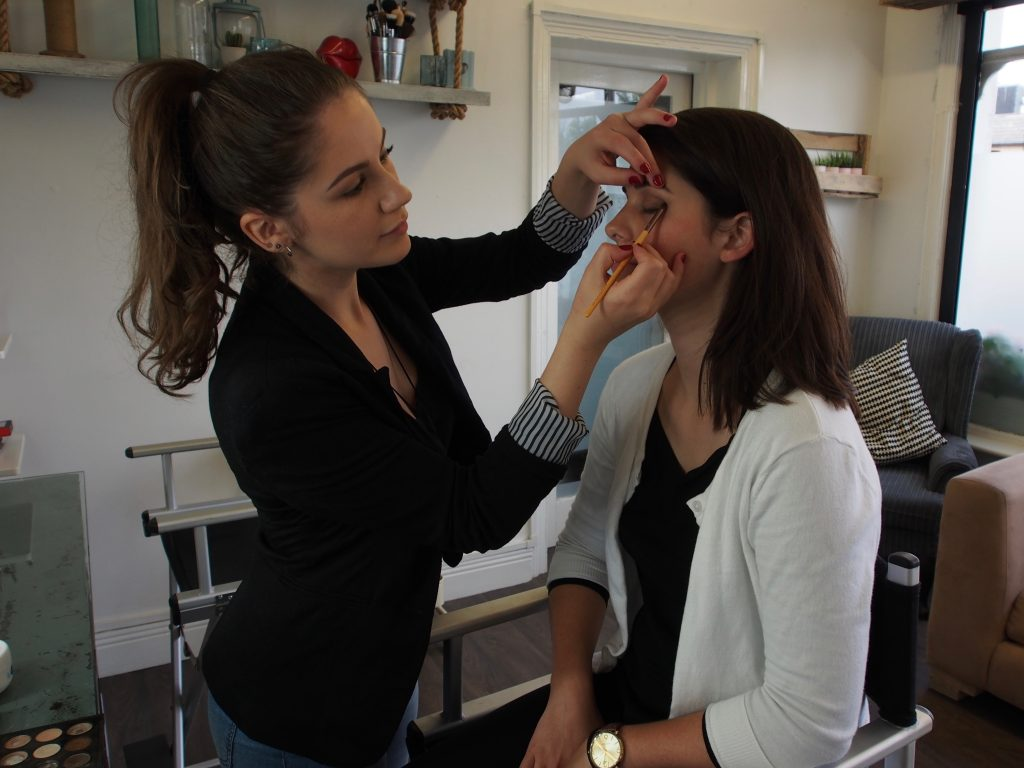 Samantha at work creating a neutral but eye-enhancing look.